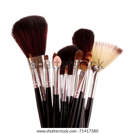 cosmetic brushes on white - stock photo