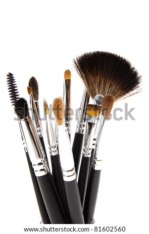 cosmetic brushes on white - stock photo