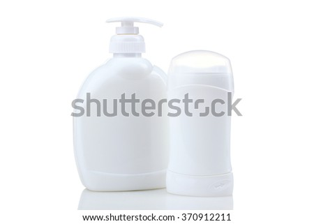 cosmetic container with liquid soap and a deodorant stick container. Design white plastic bag isolated on white background - stock photo