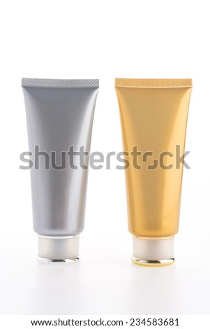 Cosmetic cream bottle isolated on white background - stock photo