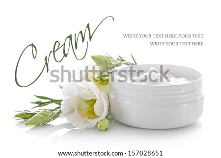 cosmetic cream container with white flowers - stock photo