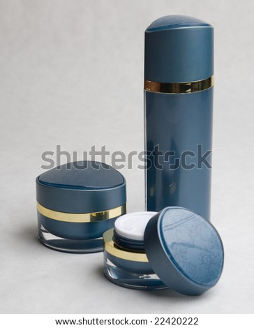 Cosmetic cream containers and bottles - stock photo