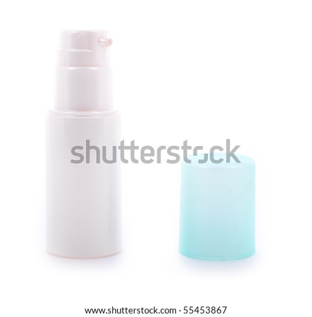 Cosmetic cream dispenser with cap - stock photo