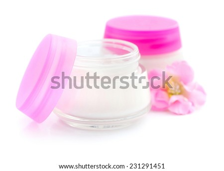 Cosmetic creams and pink flowers isolated on white background - stock photo