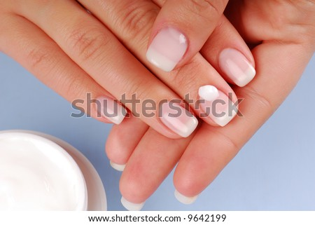Cosmetic. Drop of moisturizer on the midle woman finger.