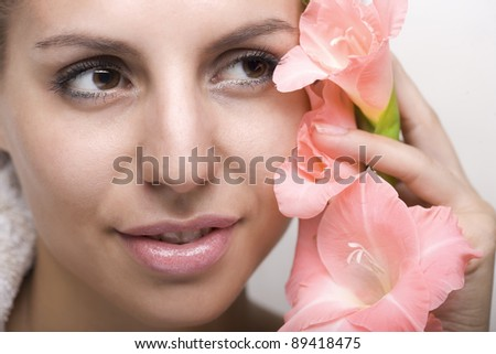 Cosmetic-female face with orchid