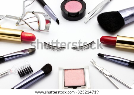 cosmetic frame with eye lash on white background