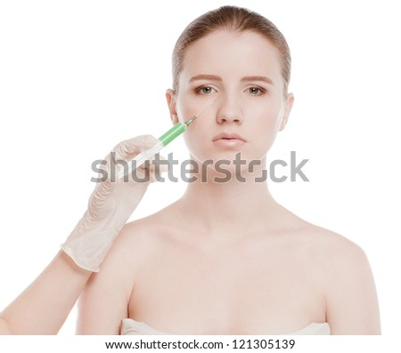 Cosmetic injection in the female face. Eye and eyebrow zone. Isolated on white - stock photo