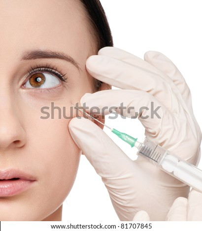 Cosmetic injection in the female face. Eye zone. Isolated - stock photo