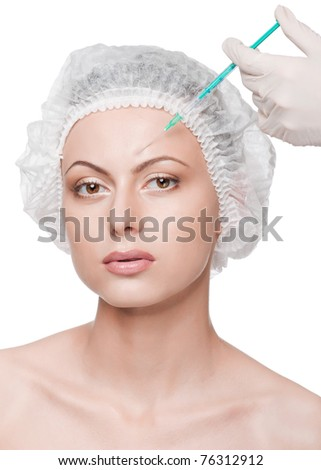 Cosmetic injection in the female face. Eyebrow zone. Isolated - stock photo