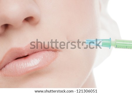 Cosmetic injection in the female face. Lips and cheek zone. Isolated on white