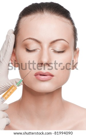 Cosmetic injection in the female face. Lips zone. Isolated
