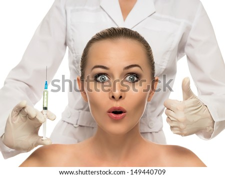Cosmetic injection to the pretty Beautiful woman face and beautician hands with syringe. Doctor woman giving botox injections. Isolated on the white background. - stock photo
