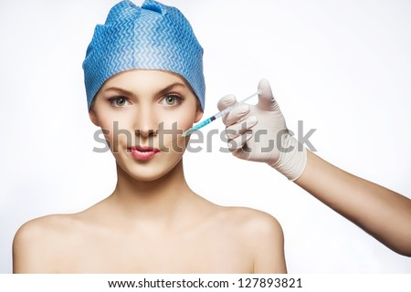 Cosmetic injection to the pretty female face. - stock photo