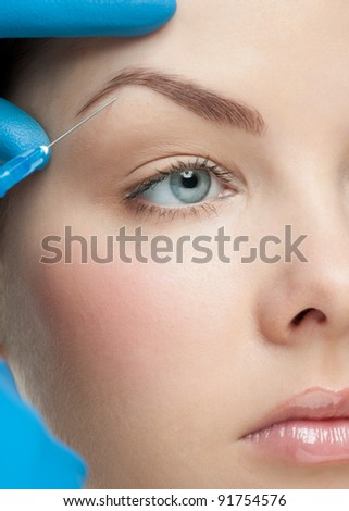 Cosmetic injection to the pretty female face - stock photo