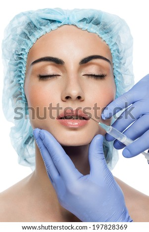Cosmetic injection to the pretty woman face on white background