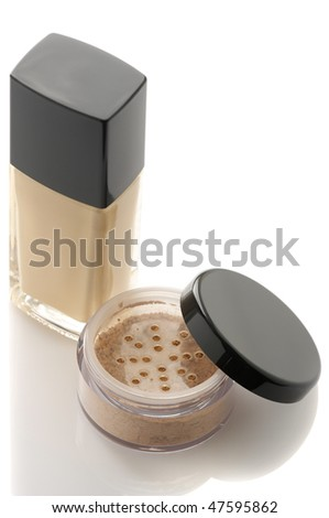 Cosmetic liquid foundation and mineral powder on white background. - stock photo