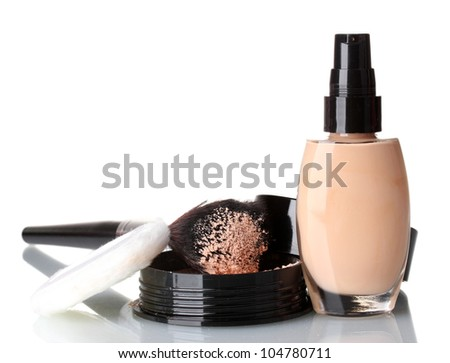 Cosmetic liquid foundation with powder on white - stock photo