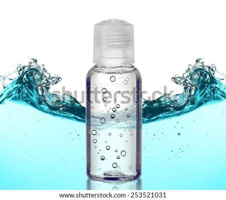Cosmetic liquid in vial on abstract water wave background - stock photo