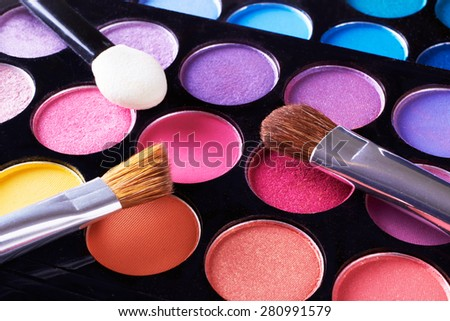 Cosmetic.Makeup with different type of brushes and applicator.Close up macro.Eye-shadow pallet for professional make up artist.