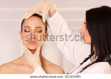 Cosmetic medicine, a doctor is examining patient's face