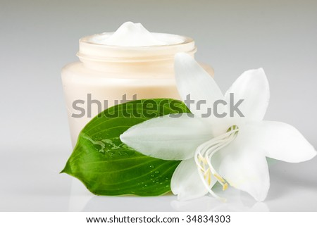 cosmetic moisturizing cream with flowers