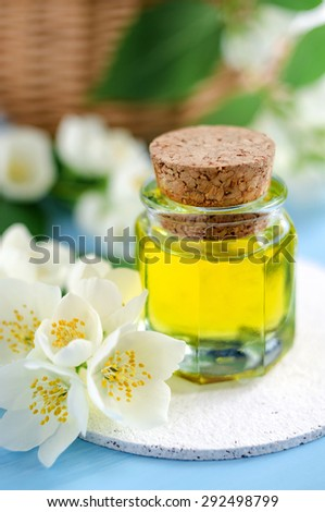 Cosmetic oil (perfume) with jasmine essence - stock photo