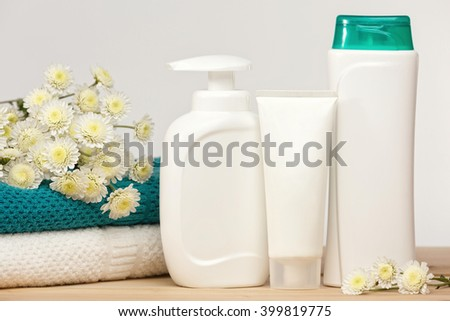 Cosmetic packaging mock up.White soap bottle,hand creme and body lotion.