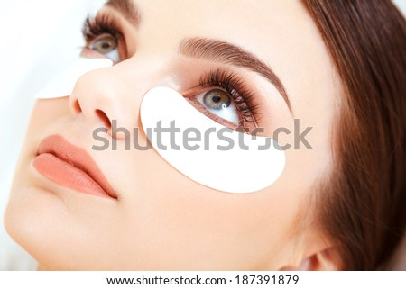Cosmetic Treatment. Woman Eye with Long Eyelashes. Eyelash Extension - stock photo