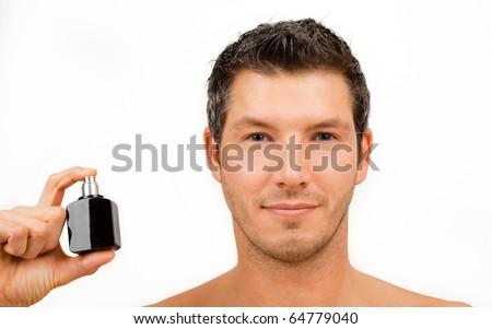 Cosmetic wellness spa man spraying fragrance - stock photo