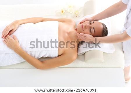 Cosmetic - woman at massage .Attractive brunette woman in spa salon. - stock photo