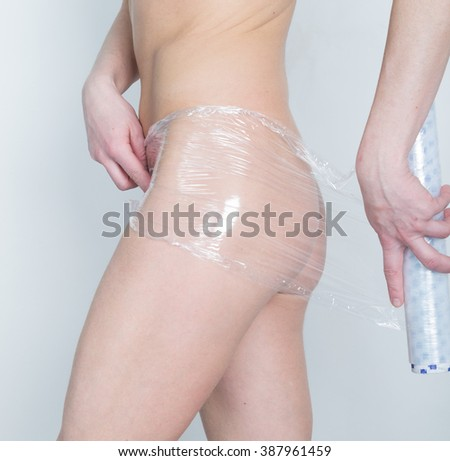 Cosmetic wrap. Slimming treatment in certain parts of the body. Caring for female body - stock photo