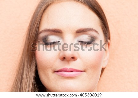 Cosmetics and beauty. Close up portrait of woman with white gray make up. Attractive girl in straight hair. - stock photo
