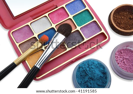 Cosmetics and brushes for a make-up on a light background - stock photo