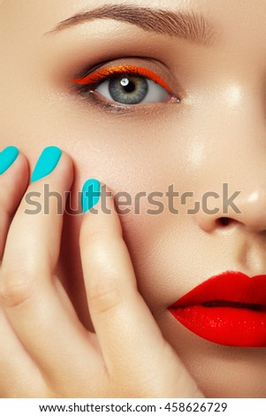 Cosmetics and makeup. Fashion model with vivid makeup and colorful nail polish. Colourful nails. Closeup portrait of fashion model with trendy makeup and mint manicure. Smoky eyes and long eyelashes