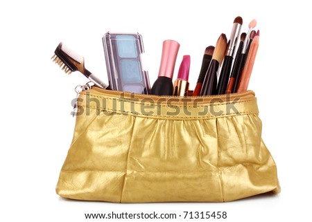 cosmetics bag with cosmetic on white - stock photo