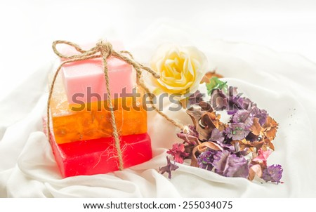 cosmetics bottles, soap and towels spa set. - stock photo