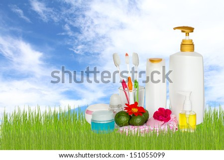 cosmetics bottles with towels and flower
