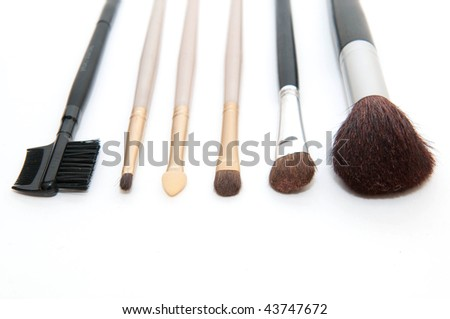 Cosmetics brushes on a white background