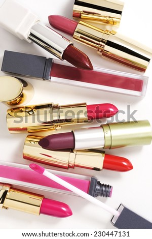 cosmetics composition on white background with light shadows - stock photo