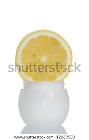 Cosmetics cream with lemon on the white background