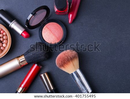 Cosmetics on black background, top view - stock photo