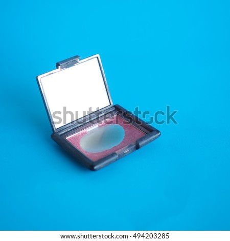 Cosmetics on blue background. Minimalism fashion style.