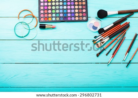 Cosmetics on blue wooden background. Top view, - stock photo