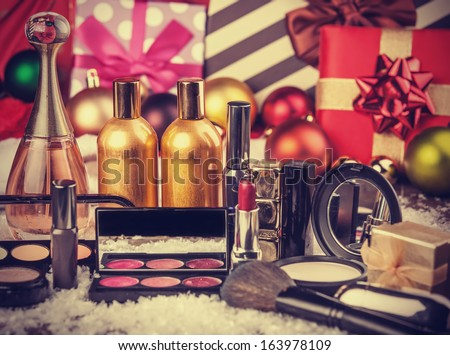 Cosmetics on christmas gifts background - stock photo