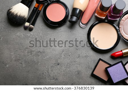 Cosmetics on dark background - stock photo