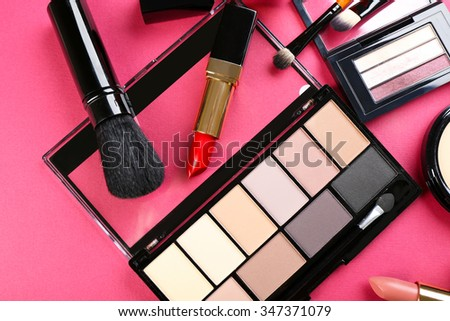 Cosmetics on pink background - stock photo