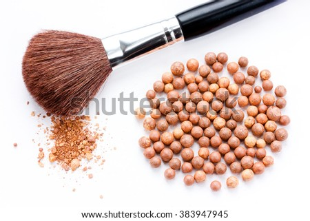 Cosmetics rouge balls with a brush isolated on white background - stock photo