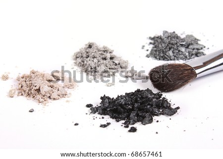 Cosmetics shadows and makeup brush on white background - stock photo