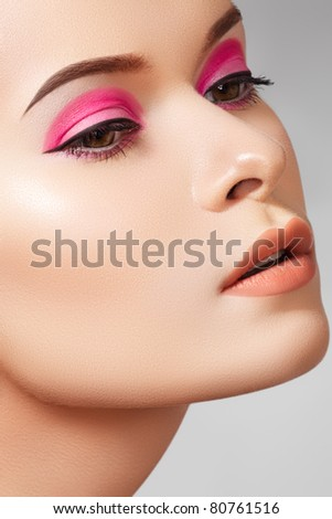 Cosmetics, skincare and visage. Close-up portrait of sexy european young woman model with glamour eye makeup with arrows, natural lips make-up, soft purity complexion. Perfect clean shiny skin - stock photo